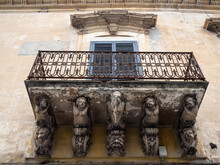 Palazzo Tommasi Rosso Tedeschi Balcony Supported By Grotesque Figures, Modica
