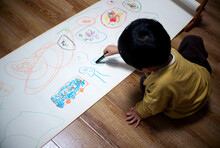 Cute Asian Chinese Little Boy Drawing At Home