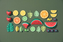 Exotic Fruits Made Of Paper On Green Background