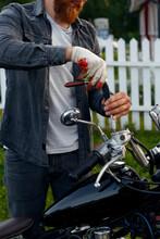 Crop Man Fixing Speedometer On Motorcycle