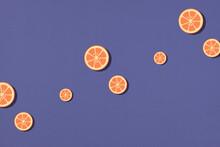 Seamless Pattern Of Orange Fruit Slice On Purple.