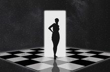 Silhouette Of A Woman At The Door