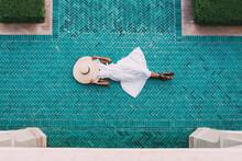 Woman Lying Down In A Geometric Mosaic Floor