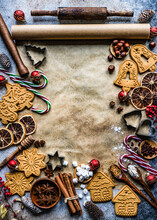 Assorted Christmas Gingerbread Cookies, Spices And Kitchen Equipment On Baking Paper