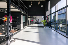 Interior Of Spacious Modern Gym With Sports Equipment