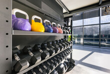 Rack With Various Kettlebells And Wall Balls