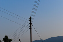 Electricity Pole Picture With Cables From Three Sides At Evening Time