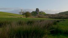 Slow Low Level Panning Shot Of Corfe Castle, Early Morning Light.