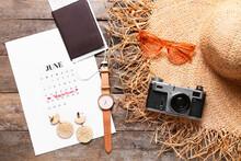 Calendar, Passport, Medical Mask And Beach Accessories On Wooden Background