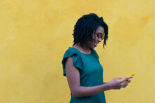 Portrait Of A Young Woman Sending A Smartphone Message On The St