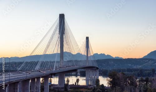 Port Mann Bridge over the Fraser River. Sunny Summer Sunset. Surrey, Vancouver, British Columbia, Canada.