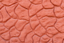 Abstract Decorative Stone Plaster Wall Texture. Red Concrete Plaster Stucco Wall. Red Wall Background