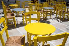 Yellow Table On Sunny Restaurant Terrace