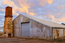 Old Shed And Stone Chimney At Sunset