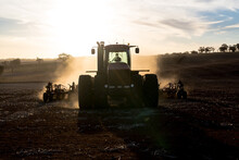 Tractor And Airseeder Planting Wheat On A Farm