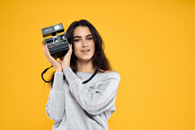 Cheerful Woman Photographer With Camera In Hands Professional Lifestyle Studio