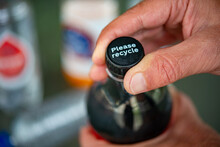 Man Turn The Lid Of  Plastic Bottle With Message 'Please Recycle' One Of Campaign To Deliver Policies Solutions For A Future Free Plastic Pollution In Netherland.