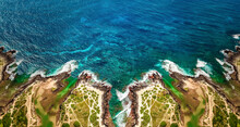 Aerial View Of Ocean Waves And Fantastic Rocky Shoreline, Aerial View Of A Coastline Along Great Ocean Road, Aerial View Of Waves Hitting Rocks On Beach With Turquoise Water
