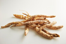 Dried Medicinal Herbs On A White Background
