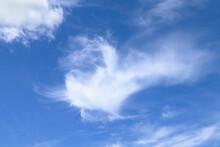 White Cirrus Uncinus Cloud On Blue Sky