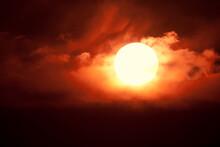 Setting Sun Among Clouds