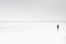 Usa, North Carolina, Surf City, Woman Walking On Misty Beach