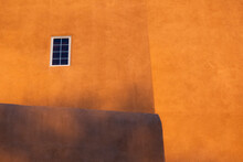 Usa, New Mexico, Santa Fe, Yellow Walls Of Adobe Style House With Window
