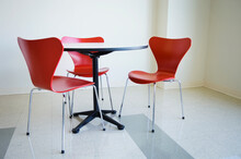 Empty Table And Red Chair In Cafeteria