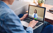 Woman talk speak using laptop computer and video conference online with doctor and stethoscope service help support team discussing and consulting talk video chat call checkup information at home