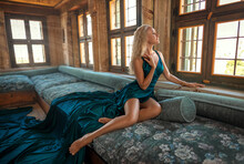 Beautiful Blonde Girl In A Long Green Dress With Perfect Legs Posing Indoor In The Old Turkish Hall.