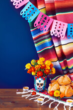 Day Of The Dead, Dia De Los Muertos Celebration Background With Marigolds Or Cempasuchil Flowers In Vase With Skull, Bread Of Death Or Pan De Muerto With Copy Space. Traditional Mexican Culture