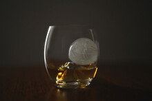 Close-up Of Wineglass On Table Against Black Background