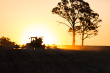 Silhouette Shot Of A Tractor And A Tree During Sunset
