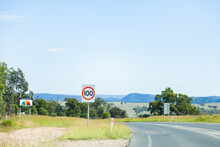 100 Max Speed Sign Beside Highway And Fire Danger Rating Sign