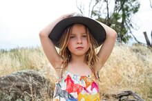 Young Girl Wearing Grey Bushman's Hat In Grassy Fields