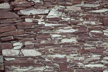 The Texture Of The Wall Is Made Of Natural Stone Flagstone. Vintage Stonework, Vintage Background. The Wall Is Made Of Stone Slabs.