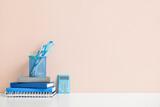 Fototapeta Kawa jest smaczna - Stylish workplace with notebooks and stationery near color wall