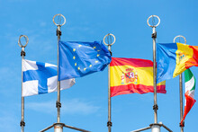 Close-up View Of European Union Flag Waving Against Blue Sky Hanging By Few Flags Of European Countries. Global Business And Communications. International Relations Theme.