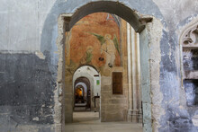 Interior Arches And Wall Paintings Inside The Abbey Of Saint-Antoine In The Department Of Isère In France