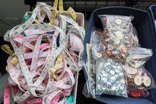 Baskets Of Colorful Measuring Tapes And Bags Of Buttons