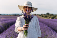 Young Woman Showing A Bouquet Of Lavender Flowers To The Camera