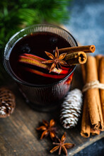 Glass Of Mulled Wine With Spices On Concrete Background