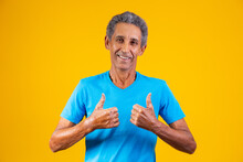 Elderly Man With Thumb Up Giving Thumbs Up.