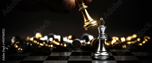 Close up king chess to challenge or battle fighting on chess board concepts of leadership and business strategy and human personal organization risk management or team player.