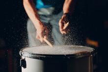 Close Up Drum Sticks Drumming Hit Beat Rhythm On Drum Surface With Splash Water Drops