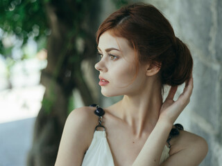 attractive red-haired Woman in white dress mythology decoration posing