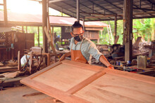 Man Doing Woodwork In Carpentry. Carpenter Work On Wood Plank In