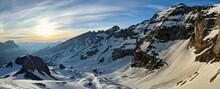 Ski Mountaineering With A Breathtaking Panorama Of The Snowy Mountains.Ski Tour On The Clariden Mountain.Sunrise Glarus