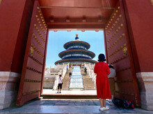 Chinese Archways, Pagodas, Temples And Palaces With Heaven Sky Clouds And Ornaments Landmarks Sightseeing In Beijing, Peking In China On Sunny Day With Red Columns And Doors