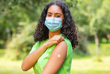 Vaccinated African American Female Young Woman Wearing Face Mask And Vaccine Band Aid